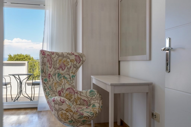 Chair and makeup table in the bedroom of Villa Makarac